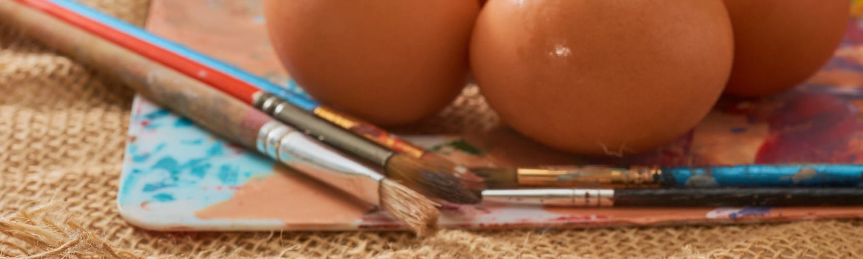 Paint brushes and eggs.